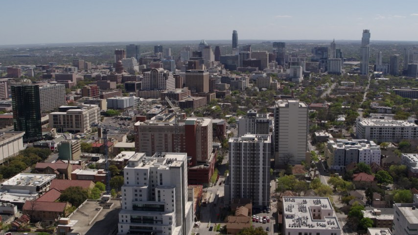 5.7K aerial video of approaching the city's skyline from the University of Texas campus, Downtown Austin, Texas Aerial Stock Footage | DX0002_107_038
