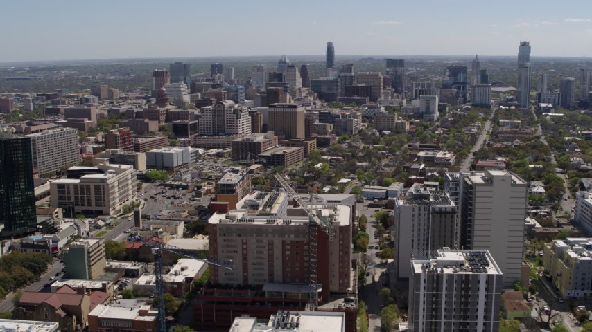 5.7K aerial video of a wide view of the city's skyline seen from the University of Texas, Downtown Austin, Texas Aerial Stock Footage | DX0002_107_039