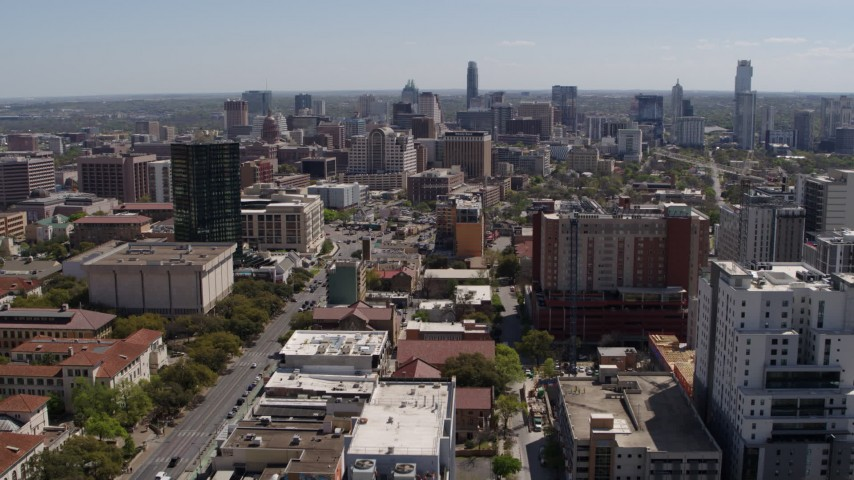 5.7K stock footage aerial video fly away from the city's skyline, seen from the University of Texas, Downtown Austin, Texas Aerial Stock Footage | DX0002_107_040