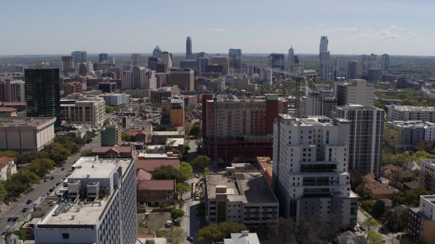 5.7K stock footage aerial video ascend from the University of Texas for view of skyline of Downtown Austin, Texas Aerial Stock Footage | DX0002_107_041