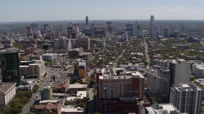 5.7K stock footage aerial video reverse view of the city's skyline, seen from the University of Texas, Downtown Austin, Texas Aerial Stock Footage | DX0002_107_042