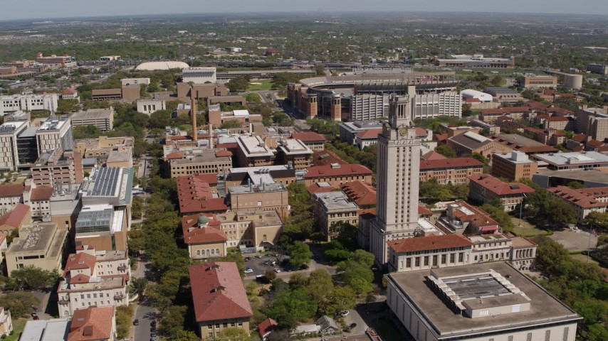 5.7K stock footage aerial video of slowly flying by campus buildings and UT Tower at the University of Texas, Austin, Texas Aerial Stock Footage | DX0002_107_043