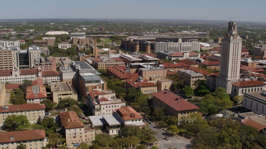 5.7K aerial video of descending by campus buildings and UT Tower at the University of Texas, Austin, Texas Aerial Stock Footage | DX0002_107_044