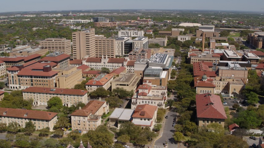 5.7K stock footage aerial video of slowly flying by campus buildings at the University of Texas, Austin, Texas Aerial Stock Footage | DX0002_107_045