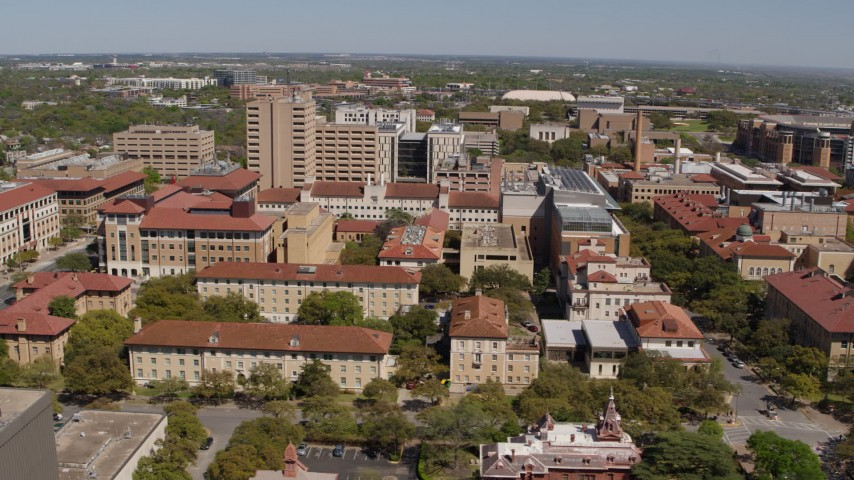 5.7K stock footage aerial video of slowly passing campus buildings at the University of Texas, Austin, Texas Aerial Stock Footage | DX0002_107_046