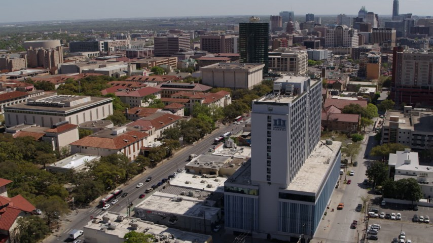 5.7K aerial video of slowly flying by dormitory near campus buildings at the University of Texas, Austin, Texas Aerial Stock Footage | DX0002_107_047