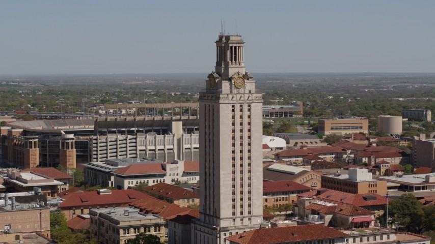 5.7K stock footage aerial video ascend and closely orbit UT Tower at the University of Texas, Austin, Texas Aerial Stock Footage | DX0002_108_002