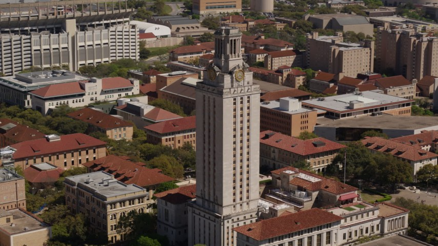 5.7K stock footage aerial video ascend and circle the UT Tower at the University of Texas, Austin, Texas Aerial Stock Footage | DX0002_108_003