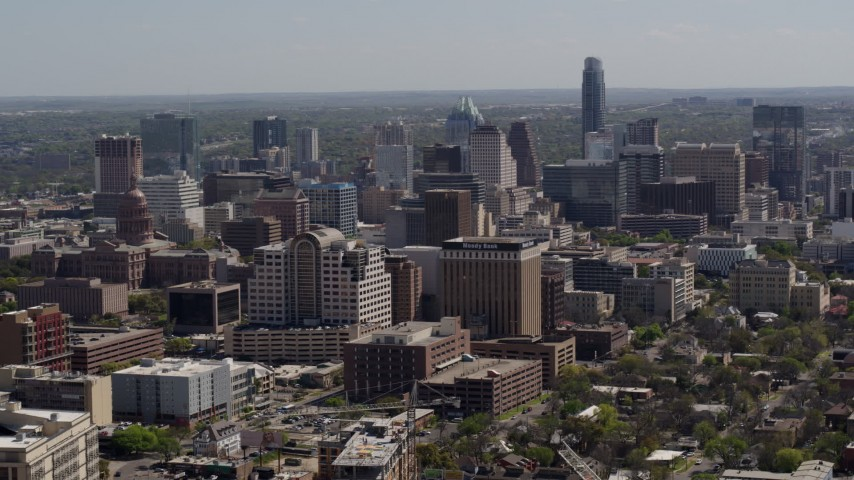 5.7K stock footage aerial video a wide view of capitol, office buildings and city skyline in Downtown Austin, Texas Aerial Stock Footage | DX0002_108_005