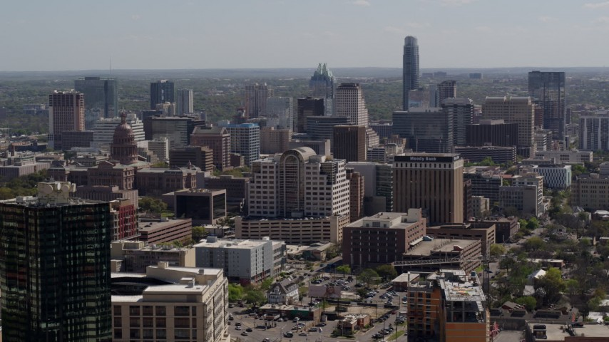 5.7K aerial video descend and fly away from capitol, office buildings and city skyline in Downtown Austin, Texas Aerial Stock Footage | DX0002_108_006