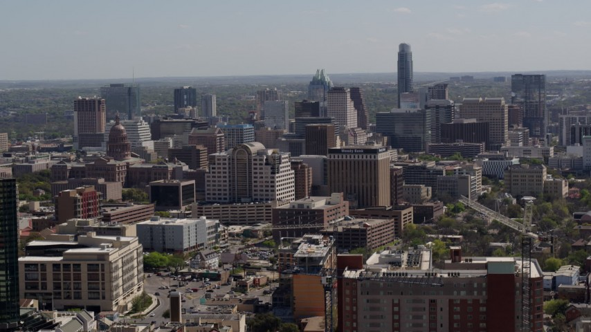 5.7K stock footage aerial video of flying by capitol, office buildings and city skyline in Downtown Austin, Texas Aerial Stock Footage | DX0002_108_007