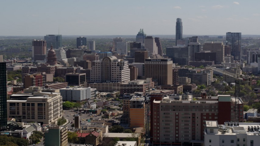5.7K stock footage aerial video descend and flyby the capitol, office buildings and city skyline in Downtown Austin, Texas Aerial Stock Footage | DX0002_108_008