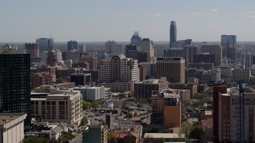 5.7K stock footage aerial video ascend to reveal and approach the capitol, office buildings, city skyline in Downtown Austin, Texas Aerial Stock Footage | DX0002_108_009