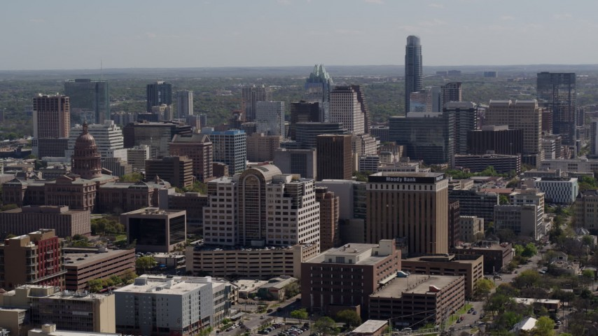 5.7K aerial video of passing the capitol and office buildings, and city skyline in Downtown Austin, Texas Aerial Stock Footage | DX0002_108_010