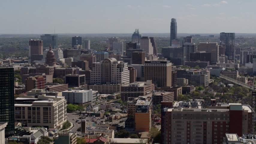 5.7K aerial video of a reverse view of the capitol and office buildings, and city skyline in Downtown Austin, Texas Aerial Stock Footage | DX0002_108_011