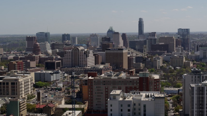 5.7K aerial video of passing the capitol and office buildings, and city skyline in Downtown Austin, Texas Aerial Stock Footage | DX0002_108_012
