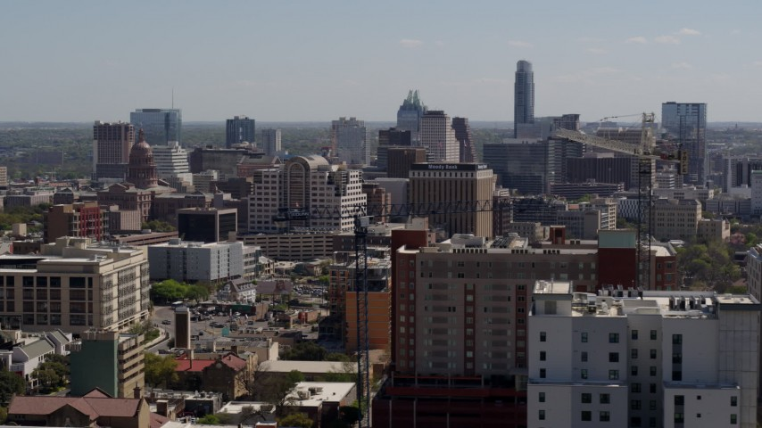 5.7K stock footage aerial video slowly passing the capitol and office buildings, and city skyline in Downtown Austin, Texas Aerial Stock Footage | DX0002_108_013