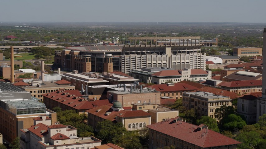 5.7K stock footage aerial video of the football stadium at the University of Texas, Austin, Texas Aerial Stock Footage | DX0002_108_014