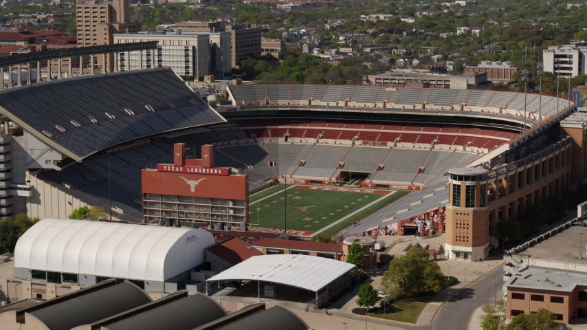 5.7K stock footage aerial video of a view of the empty football stadium at the University of Texas, Austin, Texas Aerial Stock Footage | DX0002_108_023