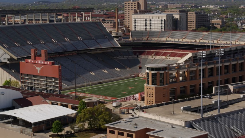 5.7K stock footage aerial video of the empty football stadium at the University of Texas, Austin, Texas Aerial Stock Footage | DX0002_108_024