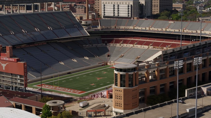 5.7K aerial video ascend to focus on the empty football stadium at the University of Texas, Austin, Texas Aerial Stock Footage | DX0002_108_025