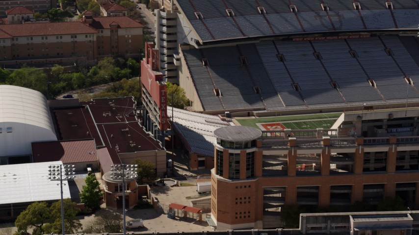 5.7K aerial video orbit scoreboard at the empty football stadium at the University of Texas, Austin, Texas Aerial Stock Footage | DX0002_108_027