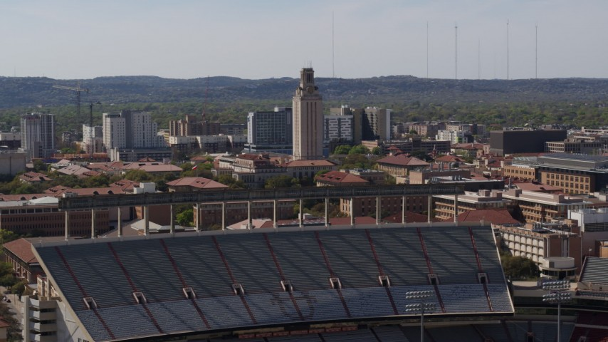 5.7K aerial video UT Tower seen from the football stadium at the University of Texas, Austin, Texas Aerial Stock Footage | DX0002_108_028