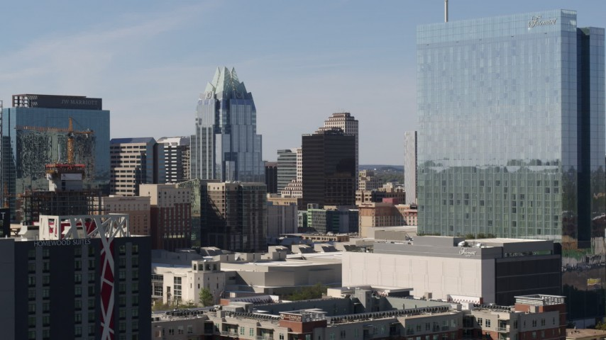 5.7K aerial video view of Frost Bank Tower from near high-rise hotel in Downtown Austin, Texas Aerial Stock Footage | DX0002_108_036