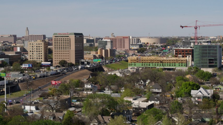 5.7K stock footage aerial video of a view of heavy traffic on a freeway in Austin, Texas Aerial Stock Footage | DX0002_108_039