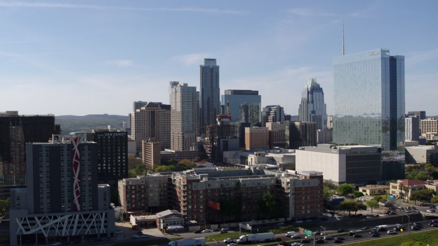 5.7K stock footage aerial video of tall city skyscrapers seen while ascending near hotel in Downtown Austin, Texas Aerial Stock Footage | DX0002_108_040