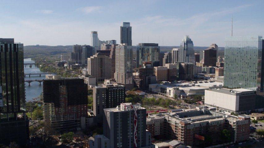 5.7K aerial video of a view of the towering city skyline while ascending in Downtown Austin, Texas Aerial Stock Footage | DX0002_108_041