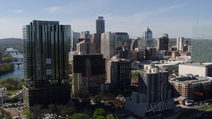 5.7K aerial video of a view of the towering city skyline during descent in Downtown Austin, Texas Aerial Stock Footage | DX0002_108_042
