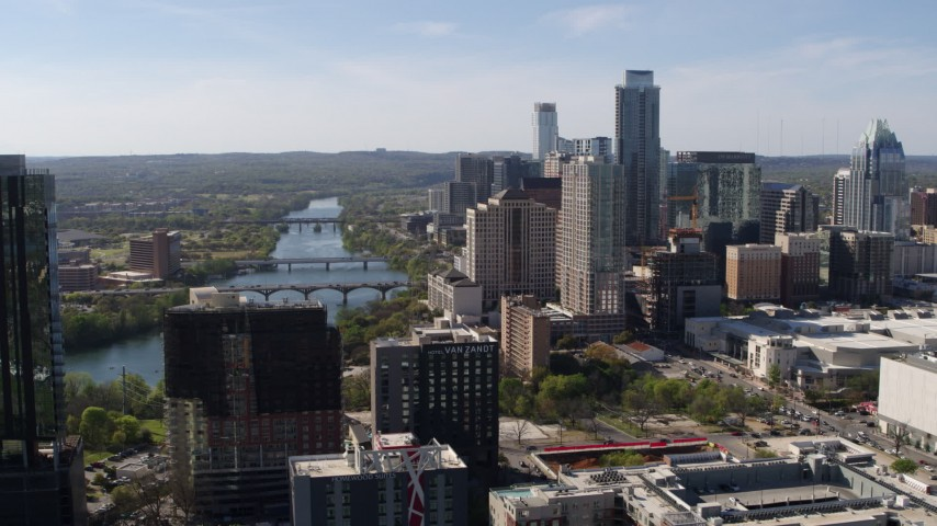 5.7K stock footage aerial video ascend for a view of the city's skyline and Lady Bird Lake in Downtown Austin, Texas Aerial Stock Footage | DX0002_108_044