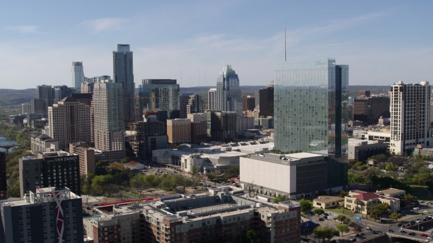 5.7K aerial video ascend to focus on hotel and the city's skyline in Downtown Austin, Texas Aerial Stock Footage | DX0002_108_048