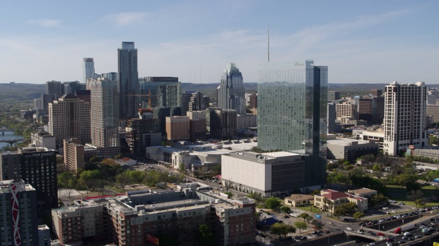 5.7K aerial video of a high-rise hotel and the city's skyline in Downtown Austin, Texas Aerial Stock Footage | DX0002_108_049