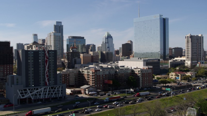 5.7K stock footage aerial video of the city's skyline and high-rise hotel seen from freeway in Downtown Austin, Texas Aerial Stock Footage | DX0002_108_051