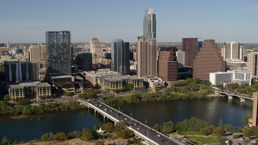 5.7K stock footage aerial video of the city's skyline across Lady Bird Lake seen from bridge, Downtown Austin, Texas Aerial Stock Footage | DX0002_109_002