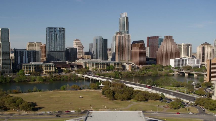 5.7K stock footage aerial video of the city's skyline on the opposite side of Lady Bird Lake seen from bridge, Downtown Austin, Texas Aerial Stock Footage | DX0002_109_003