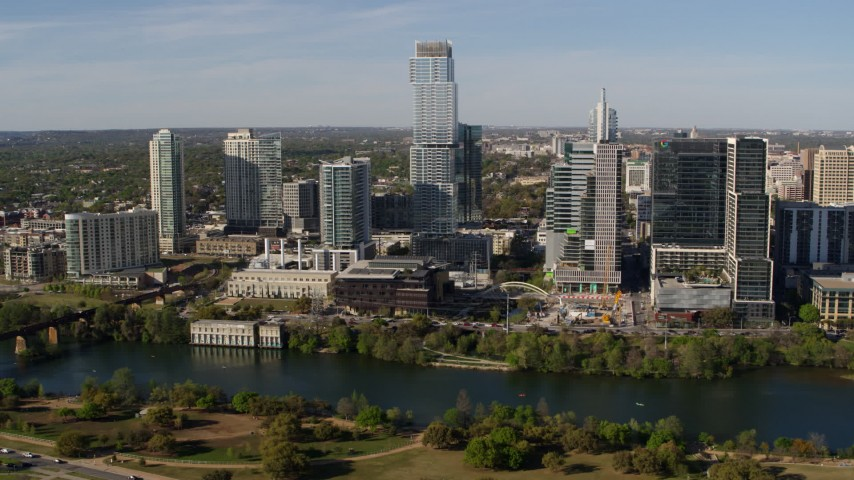 5.7K aerial video modern skyscraper across Lady Bird Lake, Downtown Austin, Texas Aerial Stock Footage | DX0002_109_005