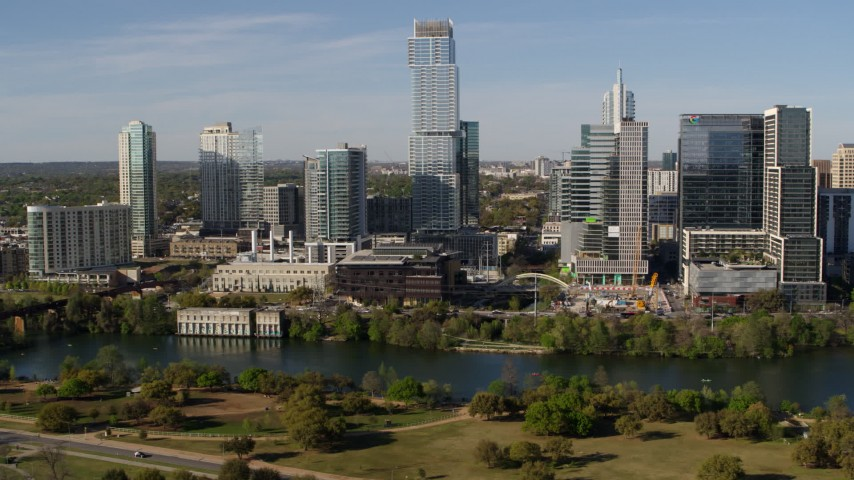 5.7K stock footage aerial video modern skyscraper on the opposite side of Lady Bird Lake, Downtown Austin, Texas Aerial Stock Footage | DX0002_109_006