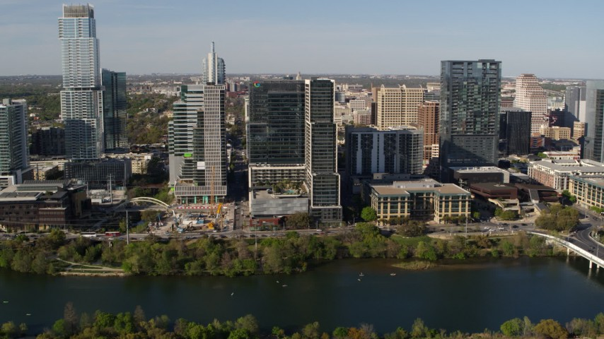 5.7K stock footage aerial video of The Northshore skyscraper on the other side of Lady Bird Lake, Downtown Austin, Texas Aerial Stock Footage | DX0002_109_010