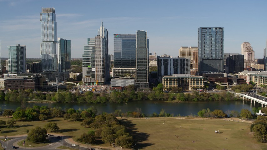 5.7K stock footage aerial video approach and flyby The Northshore skyscraper on the other side of Lady Bird Lake, Downtown Austin, Texas Aerial Stock Footage | DX0002_109_012