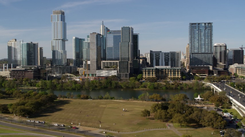 5.7K stock footage aerial video of The Northshore skyscraper on the other side of Lady Bird Lake, seen during descent, Downtown Austin, Texas Aerial Stock Footage | DX0002_109_013