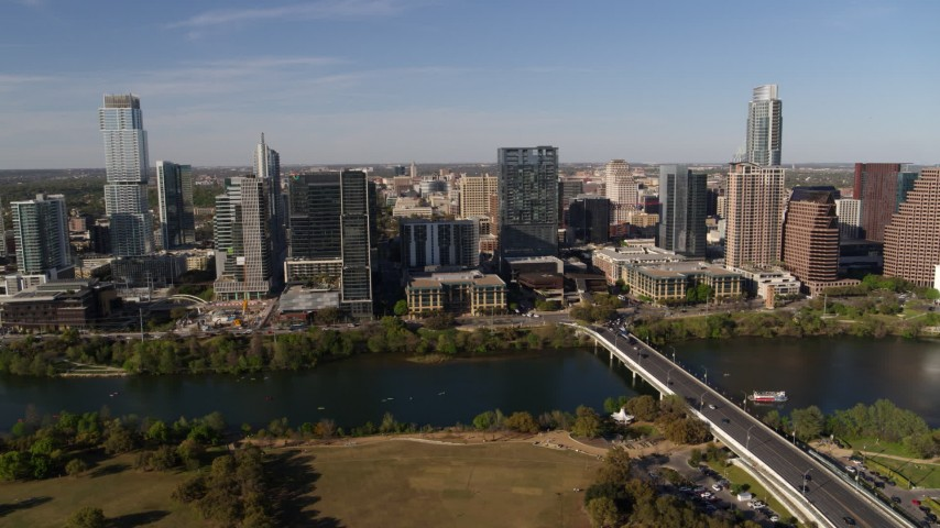 5.7K stock footage aerial video of flying by the city's waterfront skyline on the other side of Lady Bird Lake, Downtown Austin, Texas Aerial Stock Footage | DX0002_109_015