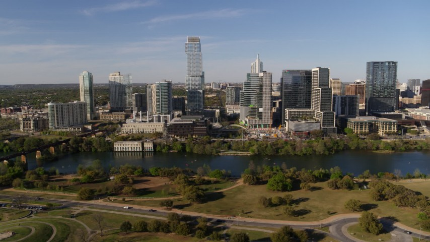 5.7K aerial video of tall skyscrapers in the city's waterfront skyline across Lady Bird Lake, Downtown Austin, Texas Aerial Stock Footage | DX0002_109_017