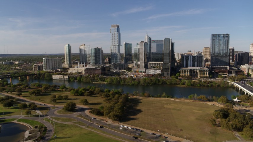 5.7K stock footage aerial video of a view of tall skyscrapers in the city's waterfront skyline across Lady Bird Lake, Downtown Austin, Texas Aerial Stock Footage DX0002_109_018 | Axiom Images