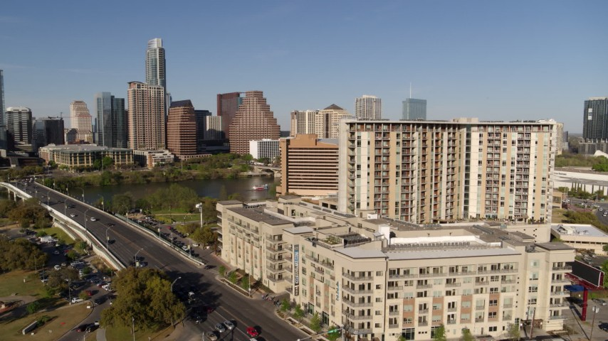 5.7K stock footage aerial video of the city's waterfront skyline seen from apartment building and hotel, Austin, Texas Aerial Stock Footage | DX0002_109_019
