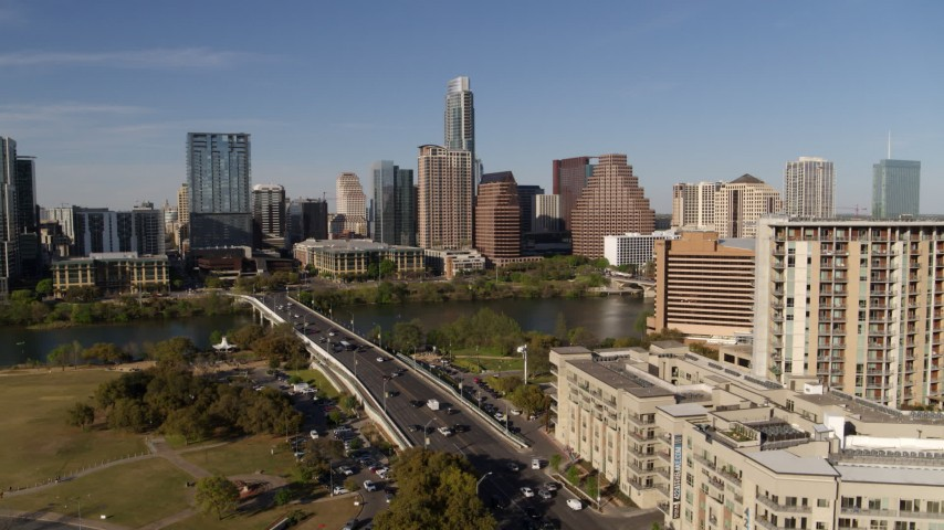 5.7K aerial video ascend for view of the city's waterfront skyline, seen from apartment building and hotel, Downtown Austin, Texas Aerial Stock Footage | DX0002_109_020