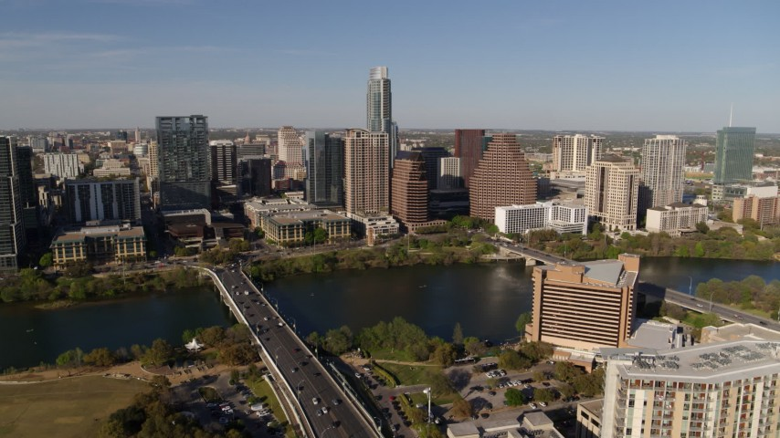 5.7K stock footage aerial video stationary view of the city's waterfront skyline and First Street Bridge, Downtown Austin, Texas Aerial Stock Footage | DX0002_109_021