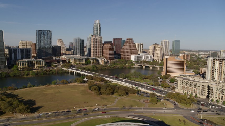 5.7K stock footage aerial video a view of the city's waterfront skyline and First Street Bridge over Lady Bird Lake, Downtown Austin, Texas Aerial Stock Footage | DX0002_109_022